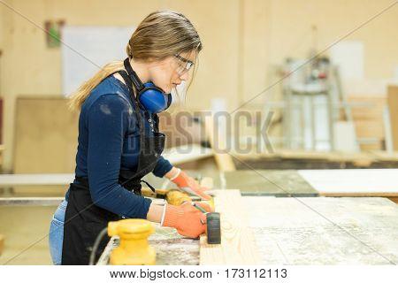 Female Carpenter Building Some Furniture