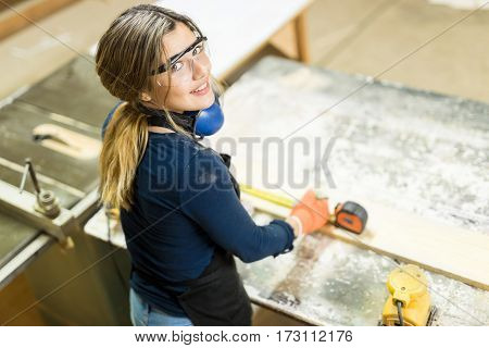 Cute Hispanic Woman Doing Some Woodwork