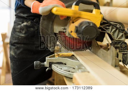 Using A Circular Saw To Cut Some Wood