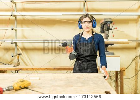Young Woman Doing Some Woodwork