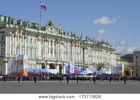 SAINT PETERSBURG, RUSSIA - MAY 09, 2015: Festive grandstand in the background of the Winter Palace. Victory day in St. Petersburg