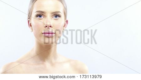 Skinecare portrait of a beautiful woman with long blonde hair. Attractive woman posing in studio over white background. Skincare concept.