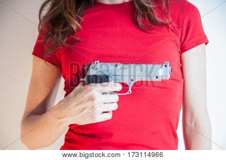 Gun In Hand Of Woman With Red Shirt