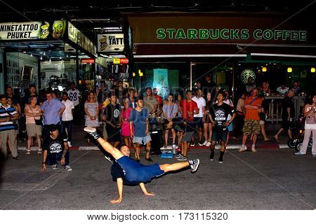 Phuket Thailand January 27 2017: A young man dancing in front of the audience on Bangla Road.