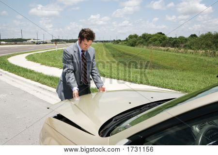 Businessman Checking Under Hood
