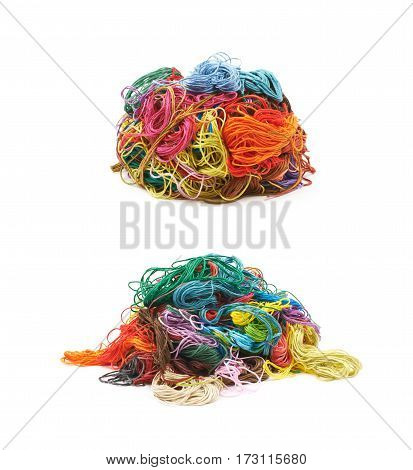 Mixed pile of colorful yarn threads isoalted over the white background, set of two different foreshortenings