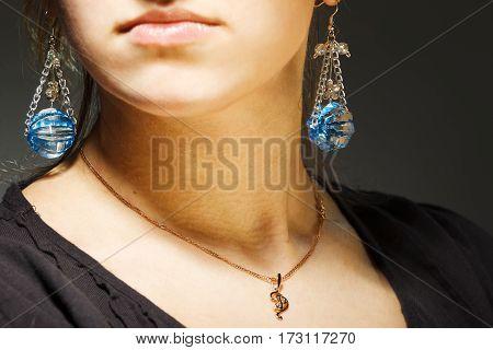 Elegant beautiful woman wearing long silver earrings.