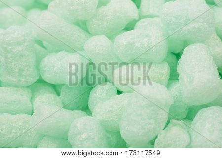 Surface covered with the multiple bioplastic packing foam peanuts as an abstract backdrop composition