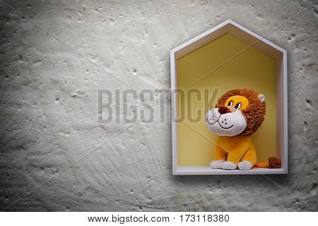 Children's toy in the house against the wall