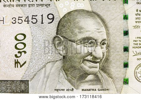 Closeup macro view of Mahatma Gandhi on the new Indian currency note of Rupees five hundred (500) denomination. Mahatma Gandhi known as Father of India Nation on Indian Rupee Currency