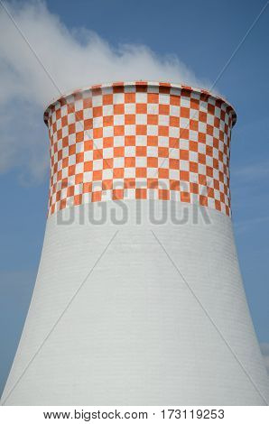 Cooling tower at coal power plant with white-and-red checkered