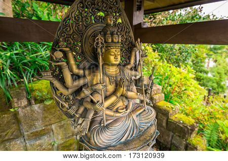 KAMAKURA, JAPAN - NOVEMBER 10, 2016: Buddist statues of Hase-dera temple in Kamakura, Japan. Hase-dera Buddhist temple is famous for housing a massive wooden statue of Kannon.