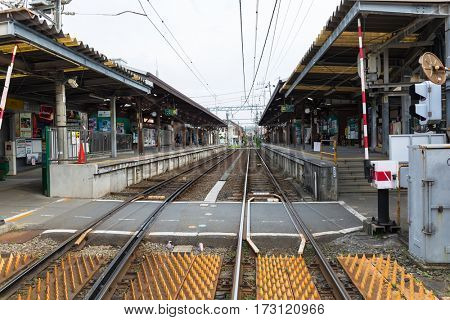 KAMAKURA, JAPAN - NOVEMBER 10, 2016: Train station platform in Kamakura, Japan. Kamakura is a popular city destination in Kanagawa Prefecture, about 50 kilometres south-west of Tokyo.