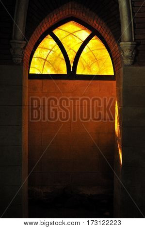 colored glass lights across stained window gothic