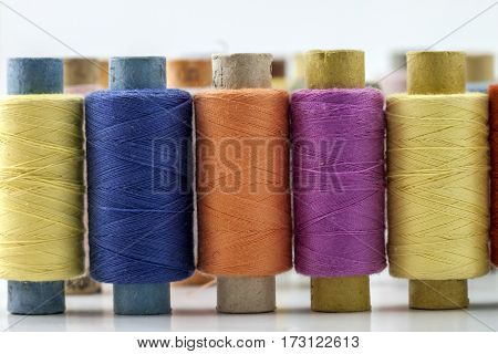 Reels Or Spools Of Multicolored Sewing Threads. Threads Of All Colors. Shallow Depth Of Field. Close
