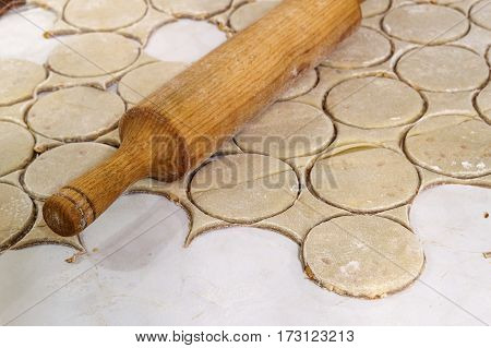 Rolling Pin With Dough On Kitchen Table. Preparing Dough Round Tortillas For Cookings To Be Baked.