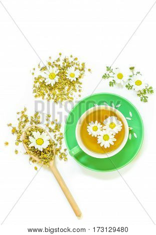 Chamomile Tea In Cup Isolated On White Background.