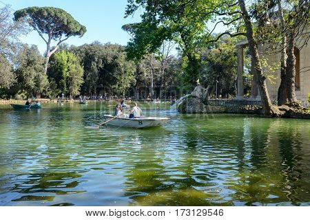 Rome Italy - April 10 2016: Nice lake called Borgese in a public garden in Rome Italy people in a boat relaxing