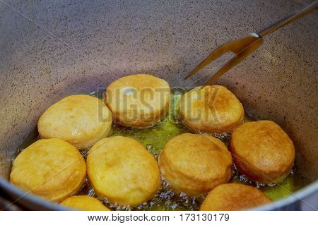 Donuts Frying In Deep Fat. Preparation Of Traditional Donuts. Frying Pan With Fat And Woman Hands Ov