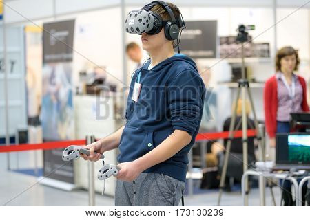 Krakow Poland - February 23 2017: Presentation of HTC VIVE - Virtual Reality System by 1000Realities Company during Mobile-IT Exhibition.