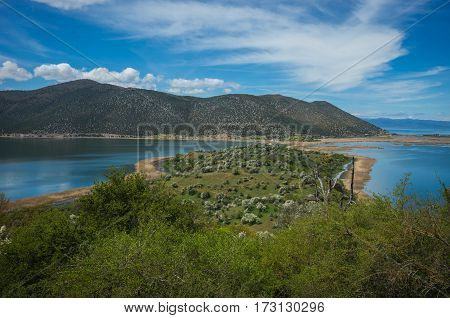 A Scenic View Of The Mountains And Lake Prespa, Greece