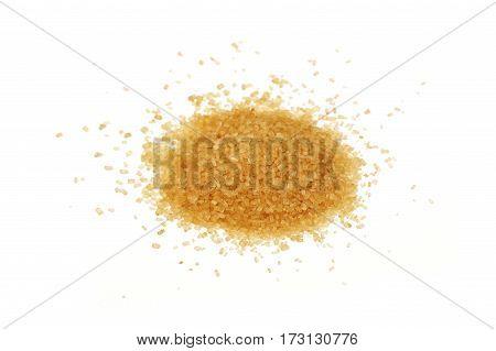 Pinch Of Brown Cane Sugar Spilled On White