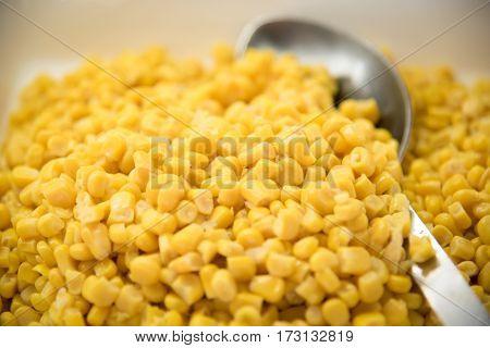 Maize corn food in a white dish , market .