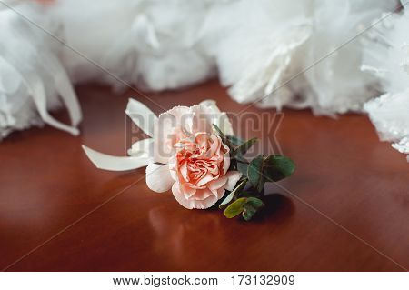 fiances wedding buttonhole made of beige rose