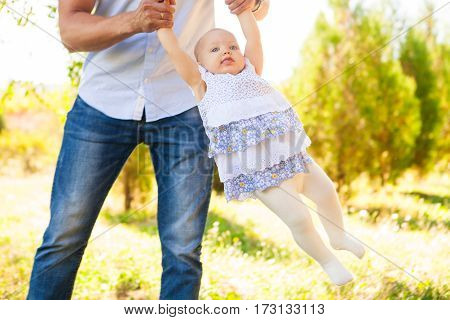 Happy Young Father With Child Spending Time Outdoor On A Summer Day, Picnic On Park.