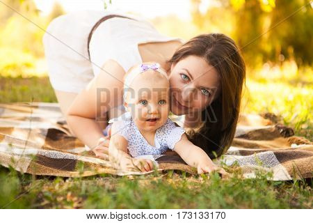Happy Young Mother With Child Spending Time Outdoor On A Summer Day, Picnic On Park.