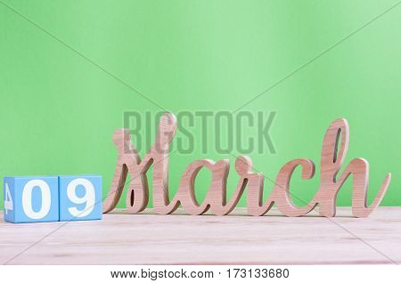 March 9th. Image of march 9 wooden color calendar on white background. Spring day, empty space for text. World DJ Day.