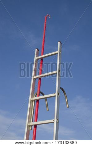 Stainless steel boat boarding ladder and red boat hook