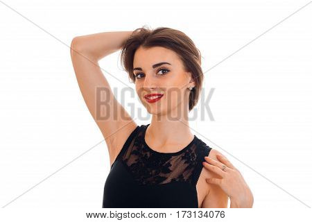 portrait of cutie young brunette woman in stylish black dress posing and looking at the camera isolated on white