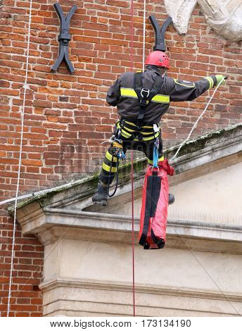 Brave Firefighters Climbing With Ropes And Climbing Equipment To