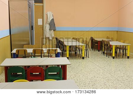Lunchroom School Without Kids With Colorful Chairs And Small Tab