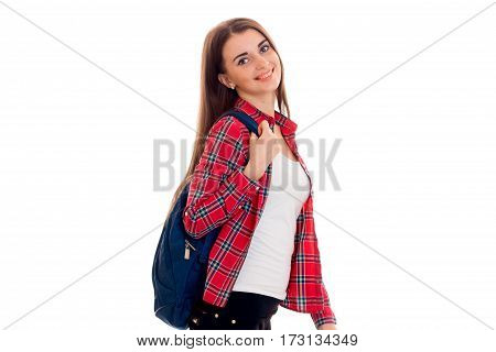 stylish cheerful brunette student girl with blue backpack looking and smiling on camera isolated on white
