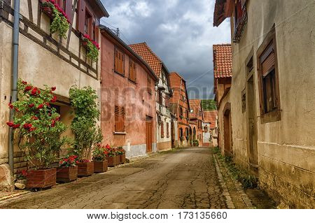 Street in Obernai city with half-timbered house, France