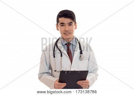 portrait of elegance brunette male doctor in blue uniform with stethoscope posing and looking at the camera isolated on white