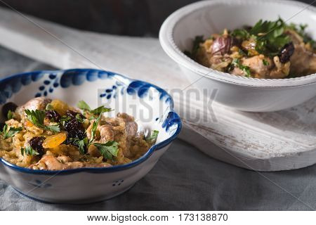 Pilaf in ceramic bowls side view horizontal