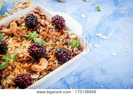 Oatmeal Crumble With Cashew, Blackberries And Mint Leaves