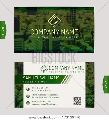 Business card for real estate company. Vector template with blurred cityscape background.