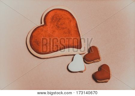Cookies in the shape of hearts close up.
