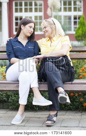 Two Friends On A Break In The Park