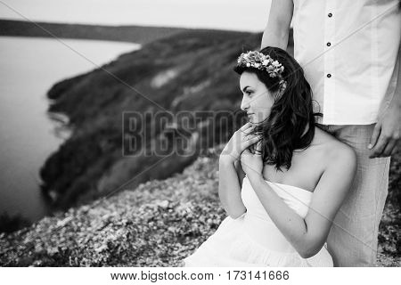 Loved Couple In Love At Amazing Landscape Against Cliff Rocks. Close Up Girl Holding Hand Of Boyfrie