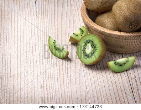 Kiwi Fruit In A Bowl On Wooden