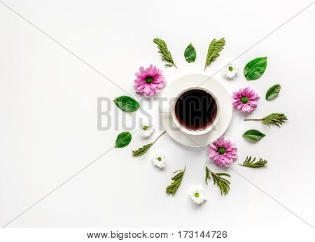 Froral flat lay with cup of coffee on white background top view mockup