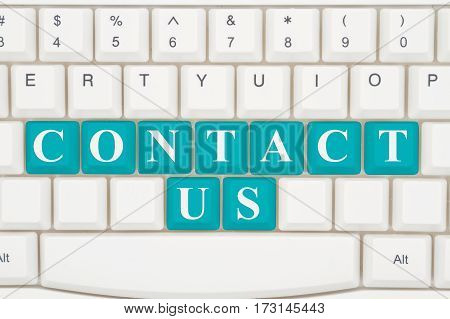 Contacting us on the internet A close-up of a keyboard with teal highlighted text Contact Us