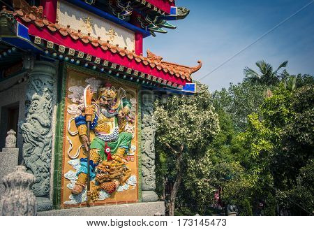 Color low relief of god warrior in Sik Sik Yuen Wong Tai Sin temple in Hong Kong. Home to three religions: Taoism, Buddhism and Confucianism.