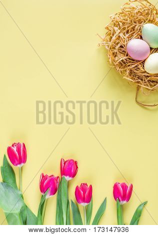 Easter concept on yellow background top view mockup.