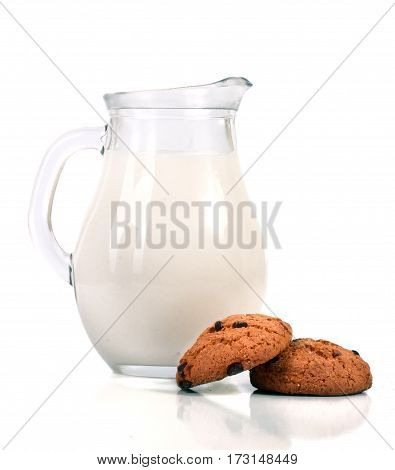jug of milk with oatmeal cookies isolated on white background.